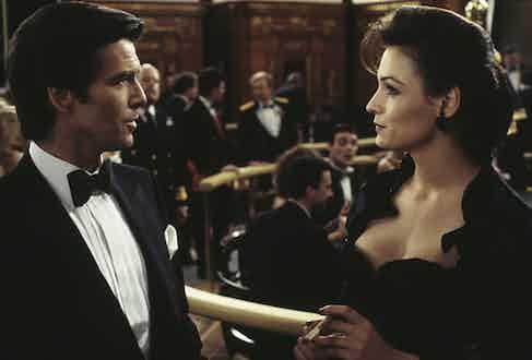 Pierce Brosnan stars as James Bond alongside Famke Janssen as the villainous Xenia Onatopp in the film 'GoldenEye', 1995.