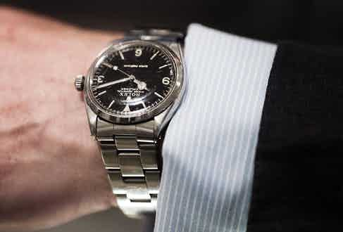 Jeremy's watch is a beautifully understated Rolex Explorer, the type of vintage watch that suits any out t and is one of the great gentlemen's accessory watches, looking great on both formal and casual occasions.