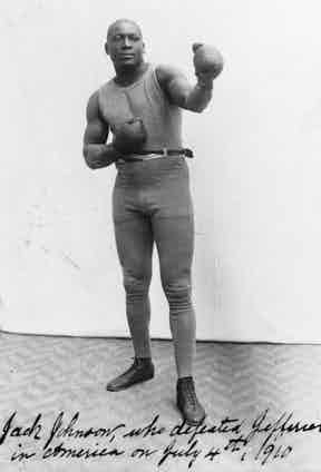 4th July 1910:  American boxer Jack Johnson after he defeated Jim Jeffries in Reno, Nevada. Photo by Sean Sexton