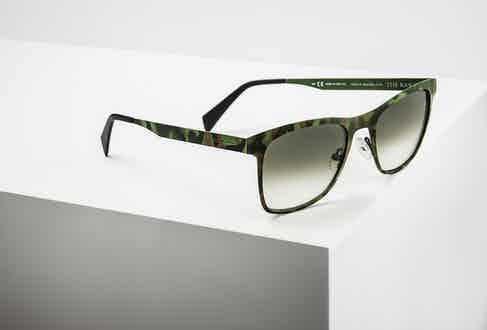 Italia Independent's gradient green lenses on display.