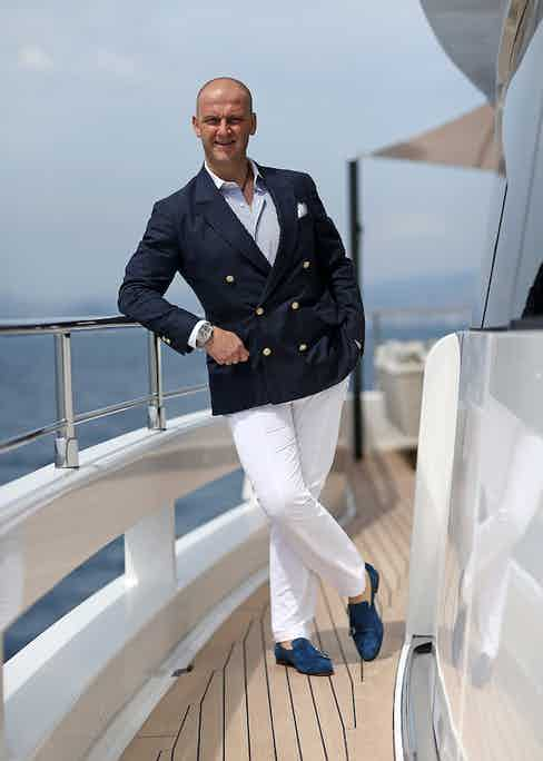 C.E.O of Santoni shoes company Giuseppe Santoni poses aboard 'Genesi' a Wider 150 yacht this May in Cannes. Photo by Pierre Suu