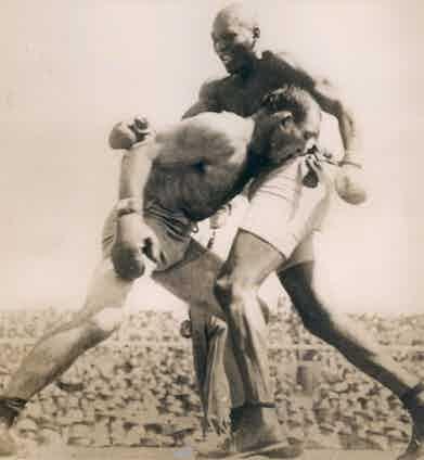 1910 Boxing match between Jim Jeffries vs. Jack Johnson. Photo by Sports Studio