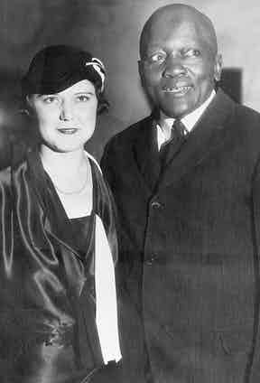 Jack Johnson standing with his fourth wife, Irene Pineau, at the opening of his nightclub, The Showboat, in Los Angeles 1931