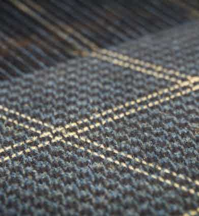A close-up of the tweed on the loom.