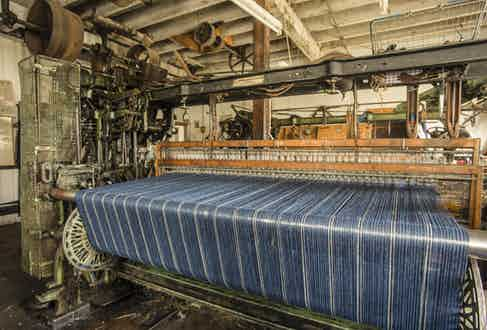 The warp running through the loom prior to weaving.