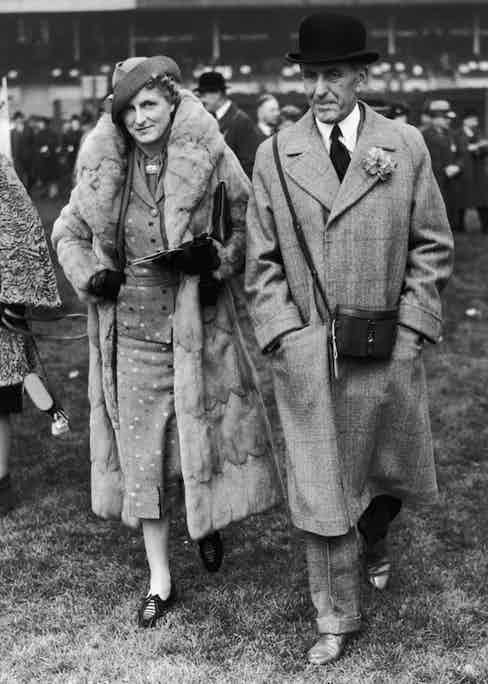Sir John Henry 'Jock' Delves Broughton and Lady Delves Broughton attend the first day of the Chester races, 2nd May 1939.