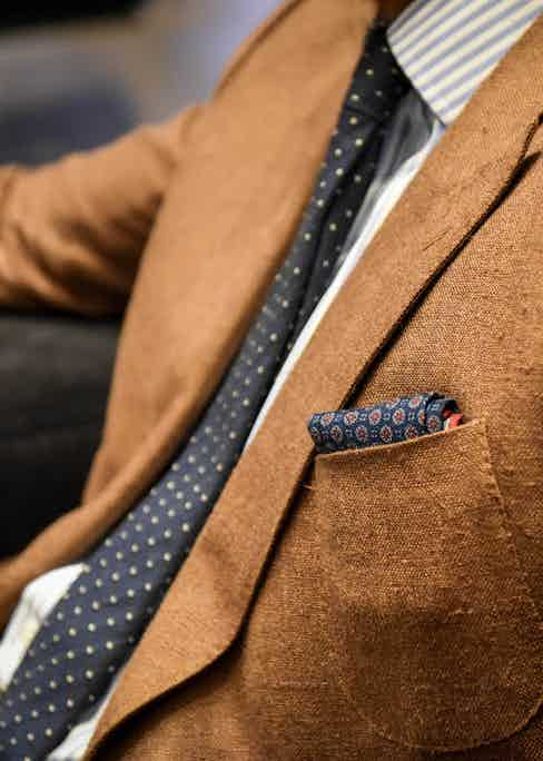 """Joe's necktie and pocket hanky are softly textured pieces from Gieves. """"For me a tie and hanky have always got to be contradictory; there's got to be some form of clash."""""""