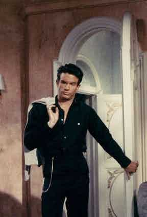 Warren Beatty wearing a dark long-sleeved shirt in The Roman Spring of Mrs Stone, 1961.