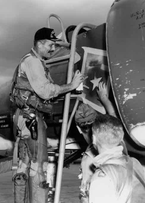 Robin Olds paints a star on an Air Force plane