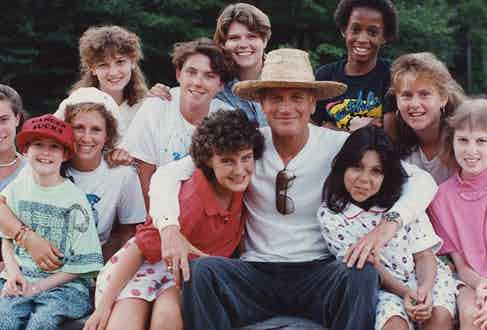 Paul Newman with kids from the Hole in the Wall Gang Camp