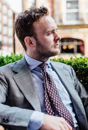 """Elliot's chosen source for ties is Liverano, who's seven folds are particularly beguiling and cut in soft washed printed silks. Elliot explains, """"this is one of my favourites, its just a lovely thing to wear – I try to wear it sparingly for fear that I'll end up destroying it in a couple of months""""."""