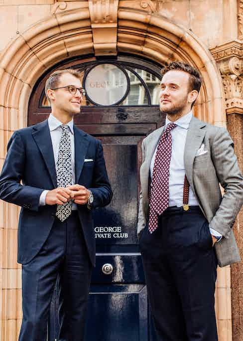 """Both wear suits by Florentine master Antonio Liverano. """"These are the first suits that Liverano made us"""" explains James, """"when we started working with Liverano & Liverano, Mr Liverano just turned round to us and said, 'if you're going to work with me, you're going to need to understand what I do. You need a blue suit and a grey suit, end of story. These are the cloths he chose for us, in the cuts he chose for us. That's what's special about Liverano; he knows exactly what you should wear, for what purpose, the colour, coordinating with the tone of your skin, your eyes, hair – everything. He creates clothes with a sense of harmony to them."""""""