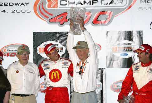 Owner Carl Haas, driver Sebastien Bourdais, owner/actor Paul Newman and Jimmy Vasser celebrate after winning the Champ Car World Series of Las Vegas at the Las Vegas Motor Speedway on September 24, 2005 in Las Vegas, Nevada (Photo by Frederick M. Brown/Getty Images)