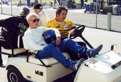 1995 – Paul Newman rides on a golf cart at Daytona International Speedway as he heads to the starting grid for the Rolex 24 at Daytona. Newman was part of a team running a Ford Mustang for car owner Jack Roush. (Photo by ISC Images & Archives via Getty Images)