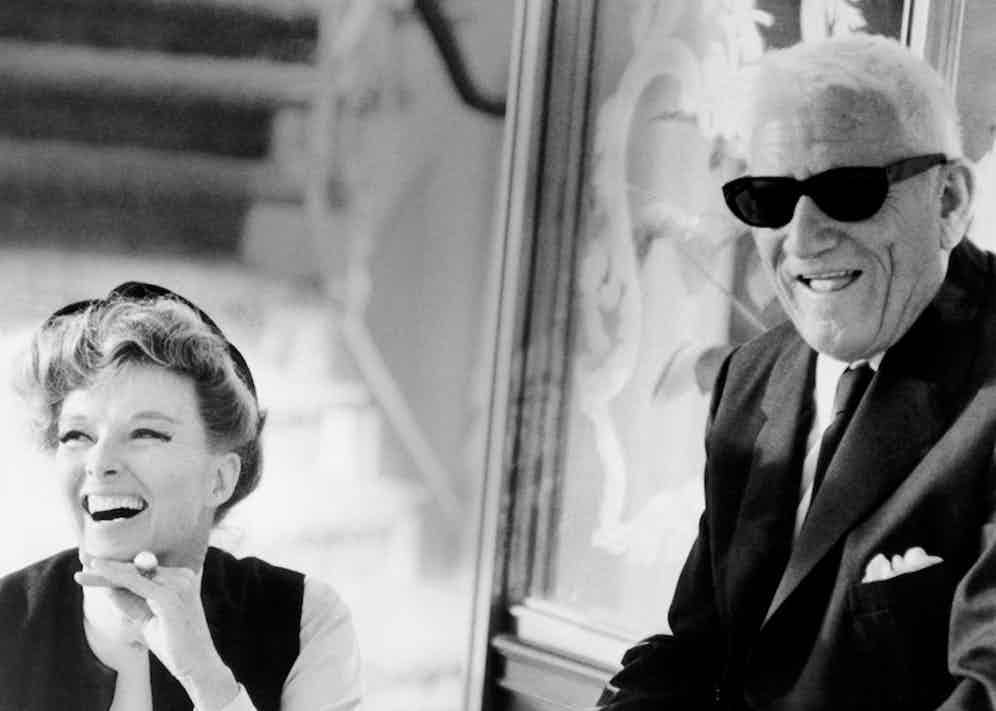 Katharine Hepburn and Spencer Tracy share a laugh during filming of the 1967 film, Guess Who's Coming to Dinner. Image © Underwood & Underwood/Corbis.