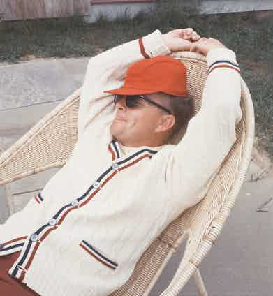Author Truman Capote relaxes in wicker chair outside his Long Island home, 1965, New York. Image by © Condé Nast Archive/Corbis.