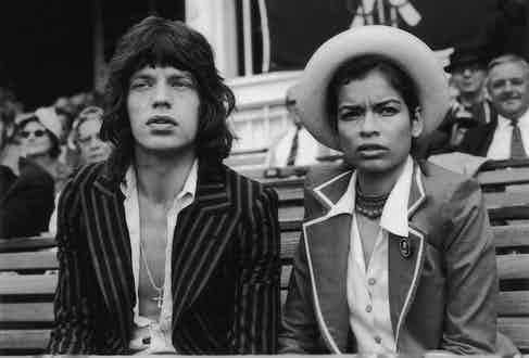 Mick Jagger,  the lead singer of 'The Rolling Stones' and his wife Bianca Jagger watching the final cricket test between England and Australia at the Oval. Photograph by Central Press/Getty Images.