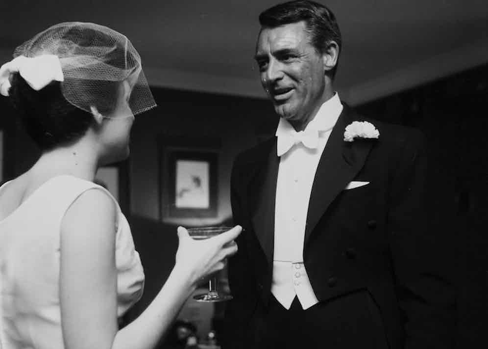 Cary Grant with Barbara Rodney at a wedding in Los Angeles, 1955. Photo by Earl Leaf/Michael Ochs Archives/Getty Images.