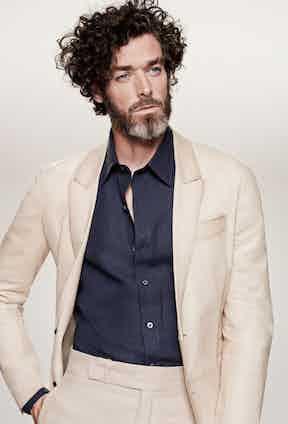 Cocoa-nut cream-brown leather sport coat, almond cotton drill trousers, both Berluti; navy linen shirt, Emma Willis.