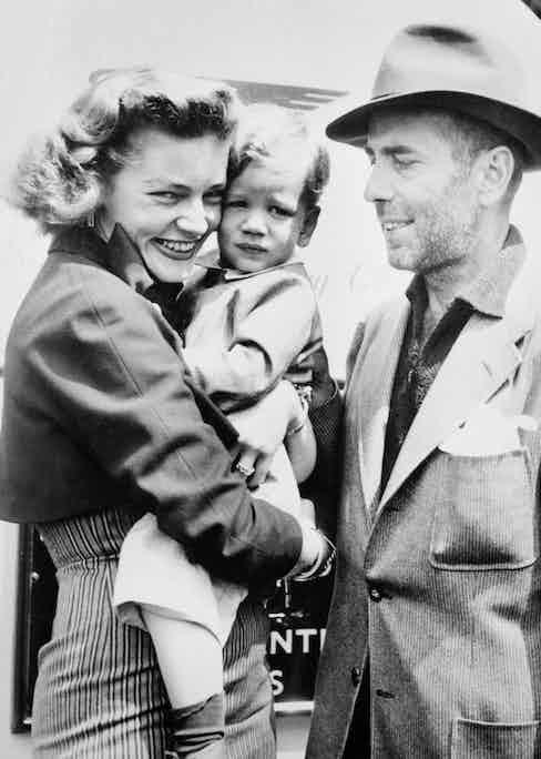 Humphrey Bogart and Lauren Bacall greet their son, Stephen, after filming The African Queen, 1951. Image © Bettmann/CORBIS