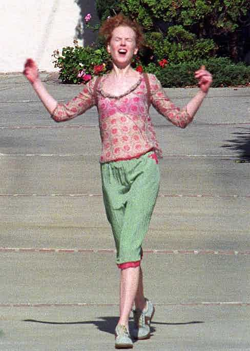 Nicole Kidman celebrates her divorce from Tom Cruise being finalised in 2001
