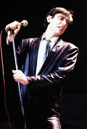 Performing on stage wearing a leather suit on his 'In Your Mind' solo tour in March 1977 in Amsterdam, Netherlands. Photo by Gijsbert Hanekroot/Redferns.