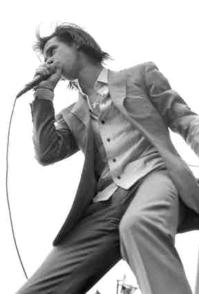 Nick Cave performs on stage in Germany, 1994. Photo by Martyn Goodacre/Getty Images.