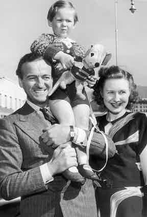 David Niven, his wife Pimulla and one of their sons David Jr., on a visit to Hollywood, 1946. Photo by Keystone-France/Gamma-Keystone via Getty Images.