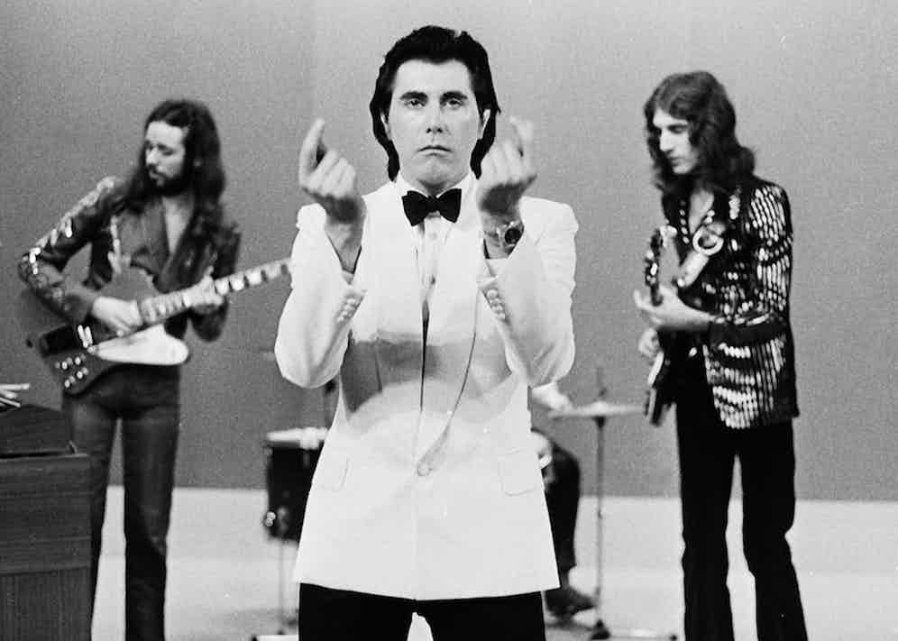 Roxy Music perfom live on TopPop TV show at Hilversum TV Studios in Hilversum, Holland in May 1973. Left to right; Phil Manzanera, Bryan Ferry and Sal Maida. Photo by Gijsbert Hanekroot/Redferns.