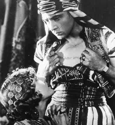 Rudolph Valentino shows off his scars to Vilma Banky in Son of the Sheik, 1926. Photo by Hulton Archive/Getty Images.