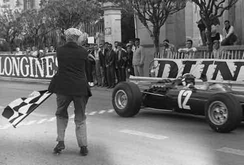 Jackie Stewart taking the checkered flag to win the 1966 Monaco Grand Prix. (Photo by Victor Blackman/Daily Express/Hulton Archive/Getty Images)
