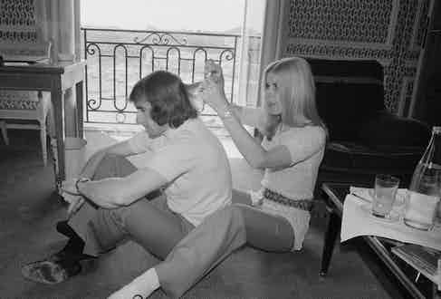 Sir  Jackie Stewart gets his hair cut by his wife Helen in Monte Carlo, Monaco, 8th May 1970. (Photo by Blackman/Daily Express/Getty Images)