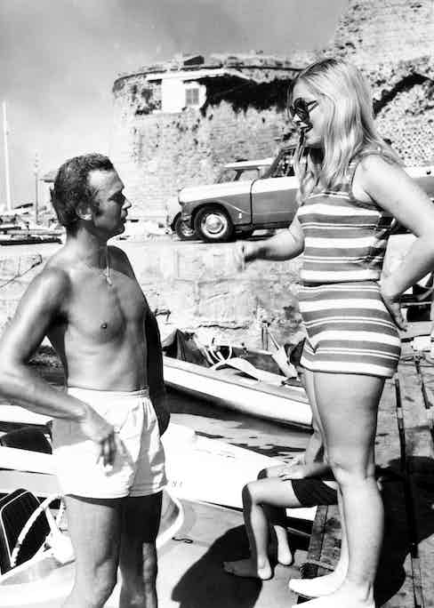 """British Royalty, Nicosia, Cyprus, August 1971, Prince Michael of Kent, who is serving with the United Nations peace keeping force in Cyprus pictured meeting """"Miss Australia 1971"""" 18 year old June Wright at Kyrenia Harbour. Photo by Popperfoto/Getty Images."""