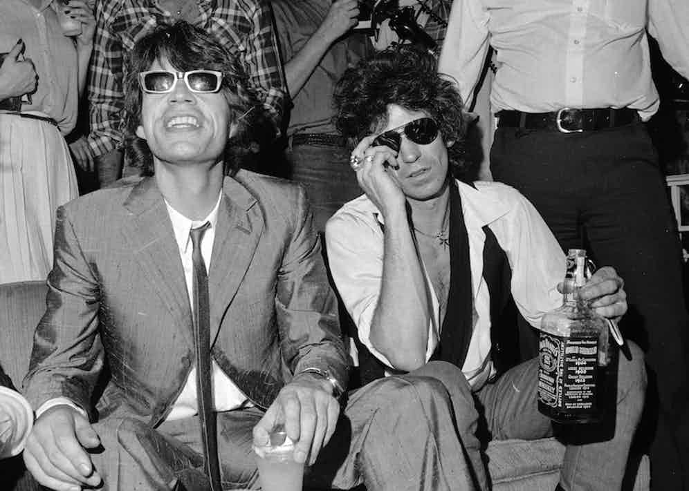 Mick Jagger, left, and Keith Richards of the Rolling Stones at a party in New York, 1980. Photograph by AP Photo/Suzanne Vlamis.