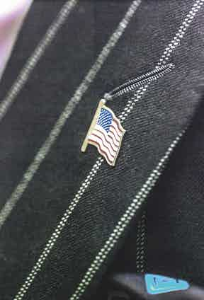 Dennis has no qualms about proclaiming himself a fan of Barack Obama. 'I'm American, baby,' he says. The presence of his patriotic lapel pin is, it seems, self-explanatory.