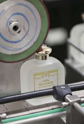 Officina Profumo-Farmaceutica Di Santa Maria Novella's perfume having its finishing touches applied.