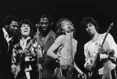 Left to right: Keyboard player Billy Preston, Giuitarist Ron Wood, percussionist Ollie Brown, singer Mick Jagger and guitarist Keith Richards, 1976. Photo by Graham Wood/Evening Standard/Hulton Archive/Getty Images.