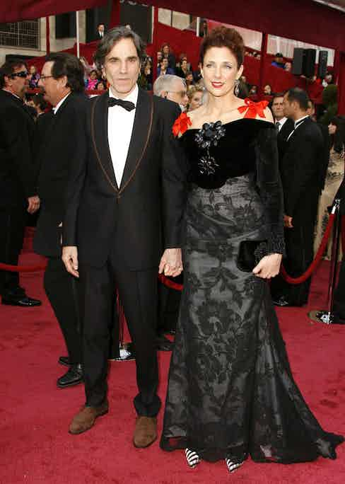 Daniel Day-Lewis and wife Rebecca Miller attend the 80th Annual Academy Awards at the Kodak Theatre on February 24, 2008 in Los Angeles, California. Day-Lewis wears Paul Smith. Photo by Jeff Vespa/WireImage.