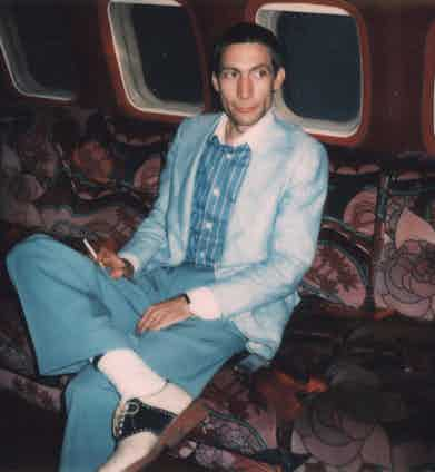 Circa 1975: Polaroid image of Charlie Watts, drummer with The Rolling Stones posed on an aeroplane circa 1975. Photo by Mark and Colleen Hayward/Redferns.