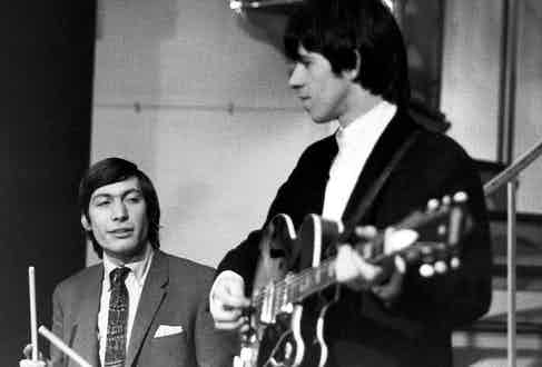 Charlie Watts with Keith Richards performing on Ready Steady Go! TV Show, at Television House studios. Photo by Val Wilmer/Redferns.