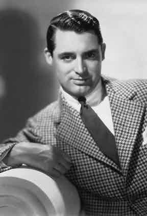 A young Cary Grant in a double-breasted tweed Prince of Wales glenplaid sportcoat and rectangular dress watch.