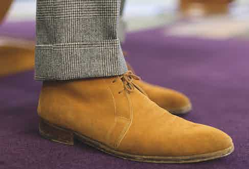 """Lorenzo wears bespoke suede boots from Dimitri Gomez. He has found himself with a large collection of suede shoes: """"I find them chic and classy."""""""