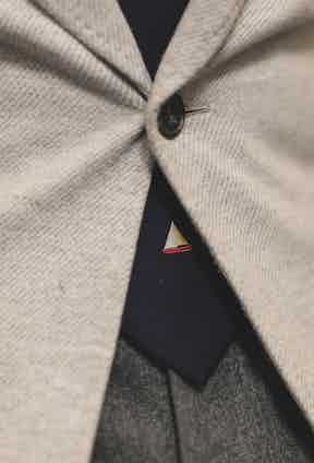 This navy tie, adorned with a cute dinghy at the end, was a present to Lorenzo from Loro Piana, friends and suppliers of Lorenzo's, at their regatta in Sardinia.