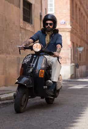 """The Concrete's founder can often be seen flying through the streets of Madrid on his beloved bike. """"This is my Vespa pk 125 cc from the 1980s. I use it a lot because I have to run errands all over the city, and I've had it since I was 18. I recently bought a Harley Davidson Sportster from 1999 for rural rides with friends. I love the sensation of freedom that comes with riding and the sound of great engineering."""""""