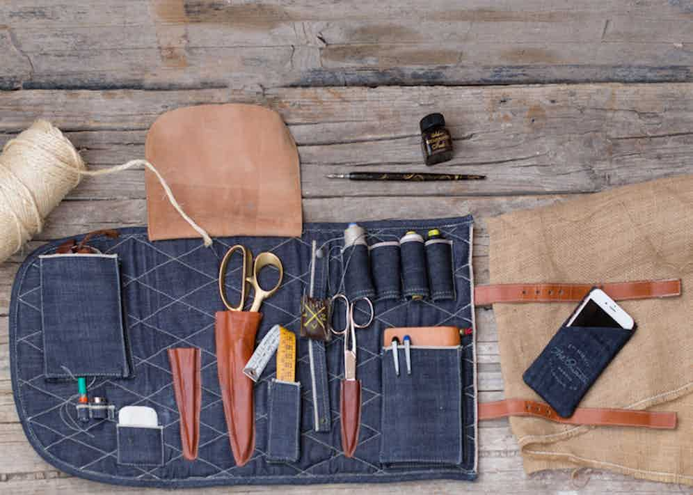 """Fernando's hands-on approach involves everything from the tools he uses to the fabrics his clients are offered. """"My dad was a pilot so although I don't have heritage tools like some of my colleagues, I have collected these from vintage markets such as 'el Rastro' in Madrid. I also made my own tailoring 'tool-roll' in selvedge Japanese denim and leather for travel or appointments outside my studio."""""""