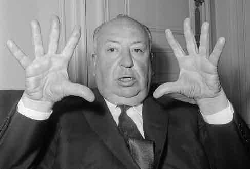 """British film director Alfred Hitchcock gestures as he gives a press conference in Paris to present his last movie """"Psycho"""", 1960. Photo credit should read STF/AFP/Getty Images."""