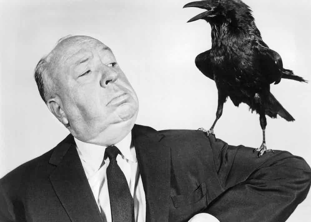 Alfred Hitchcock poses with a stuffed crow in a promotional portrait for his film 'The Birds', 1963. Photo by Silver Screen Collection/Getty Images.