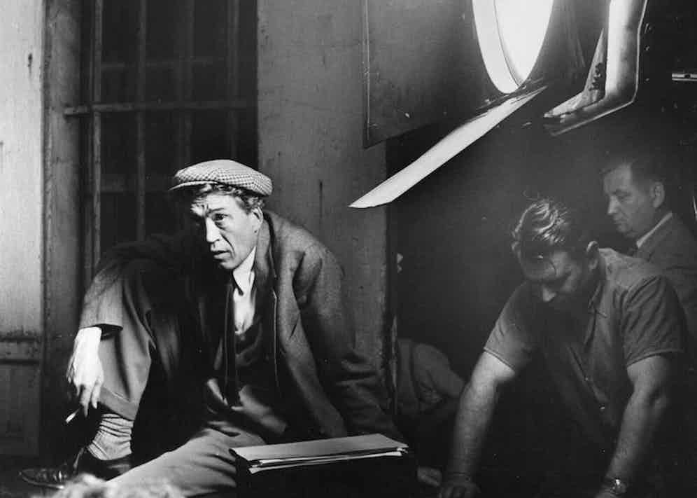 Acclaimed director John Huston watches the technicians at work during filming of 'Moulin Rouge', his fictional biopic of artist Toulouse Lautrec. Photo by Hulton Archive/Getty Images.