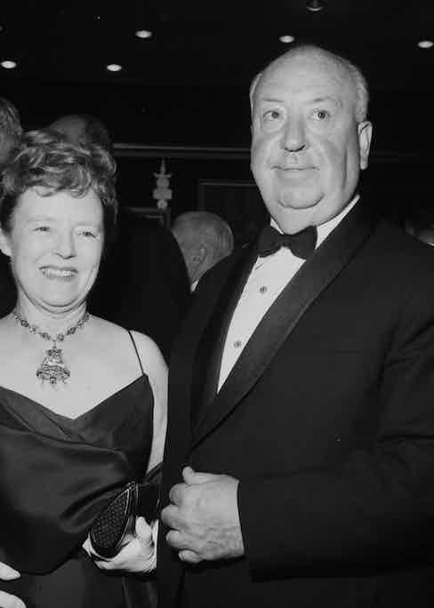Alfred Hitchcock with wife Alma Reville attends a premier in Los Angeles, California. Photo by Earl Leaf/Michael Ochs Archives/Getty Images.