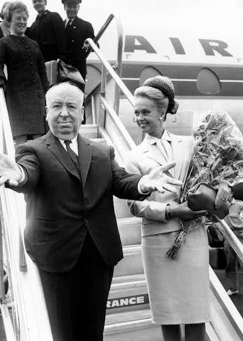 Alfred Hitchcock arriving at Nice airport with American actress Tippi Hedren on their way to to promote 'The Birds' at the Cannes Film Festival, 10th May 1963. Photo by RDA/Getty Images.